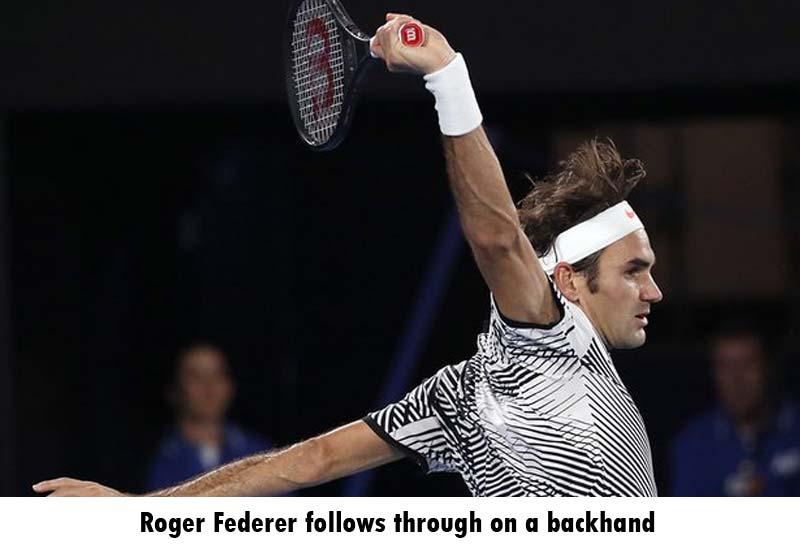 Roger Federer follows through on a backhand